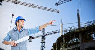Composite image of architect pointing Royalty Free Stock Photography
