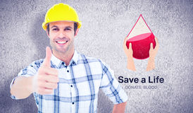 Composite image of architect showing thumbs up over white background Royalty Free Stock Image