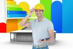 Composite image of architect wearing hard hat while holding clip board. Architect wearing hard hat while holding clip board against house with energy rating Stock Image