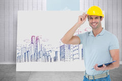 Composite image of architect wearing hard hat while holding clip board Royalty Free Stock Photography