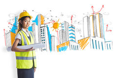 Composite image of architect woman with yellow helmet and plans Royalty Free Stock Photography