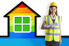 Composite image of architect woman with yellow helmet and plans Royalty Free Stock Photos
