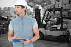 Composite image of architect writing on clip board Royalty Free Stock Image