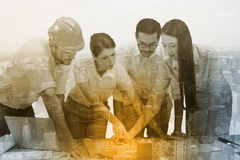 Composite image of architecture team working together at desk Royalty Free Stock Images
