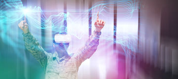 Composite image of army soldier gesturing while using virtual reality glasses. Army soldier gesturing while using virtual reality glasses against abstract Royalty Free Stock Photography