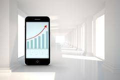 Composite image of arrows and barchart on smartphone screen Royalty Free Stock Photos