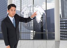 Composite image of asian businessman pointing Royalty Free Stock Photo