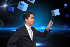 Composite image of asian businessman pointing Stock Photos