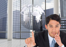 Composite image of asian businessman pointing Royalty Free Stock Photography