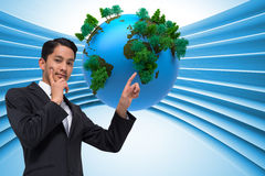 Composite image of asian businessman pointing Stock Photo