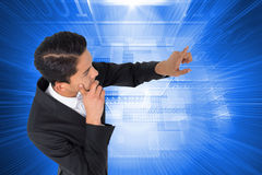 Composite image of  asian businessman pointing Stock Images