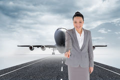 Composite image of asian businesswoman pointing Stock Image