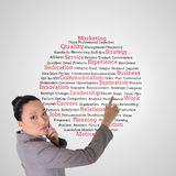Composite image of asian businesswoman pointing Stock Photography