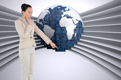 Composite image of asian businesswoman pointing Royalty Free Stock Photography