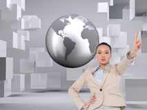 Composite image of asian businesswoman pointing Royalty Free Stock Photo