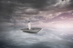 Composite image of asian businesswoman in a sailboat Stock Image