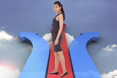 Composite image of asian businesswoman walking Stock Image