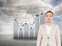 Composite image of asian businesswoman walking Stock Photos
