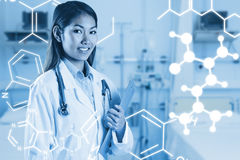 Composite image of asian doctor holding clipboard Stock Photography