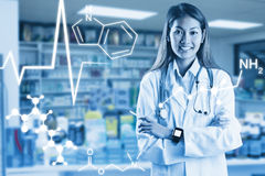 Composite image of asian doctor with smart watch crossing arms Royalty Free Stock Photos