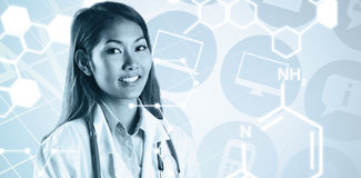 Composite image of asian doctor with stethoscope looking at camera. Asian doctor with stethoscope looking at camera against medical icons royalty free stock image