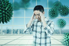 Composite image of asian man getting a headache. Asian man getting a headache against view over city royalty free stock photos