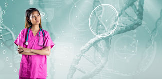 Composite image of asian nurse crossing arms Royalty Free Stock Photography