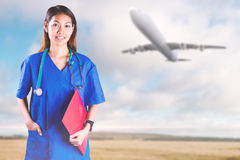 Composite image of asian nurse with stethoscope looking at the camera Royalty Free Stock Images