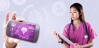 Composite image of asian nurse with stethoscope looking at the camera Stock Images