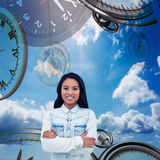 Composite image of asian woman with arms crossed smiling Royalty Free Stock Photos