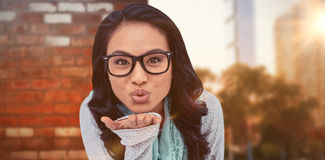 Composite image of asian woman blowing kiss to the camera Stock Photos