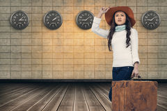 Composite image of asian woman with hat holding luggage Royalty Free Stock Photo