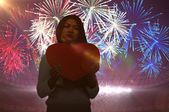 Composite image of asian woman holding paper heart Stock Image