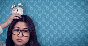 Composite image of asian woman with paper crown posing for the camera Royalty Free Stock Photos