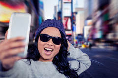 Composite image of asian woman taking selfie stock photo