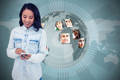 Composite image of asian woman using smartphone Stock Photos