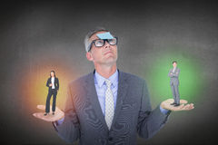 Composite image of assertive businessman standing Stock Image