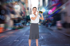 Composite image of astonished elegant businesswoman holding binoculars Stock Photos