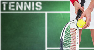 Composite image of athlete holding a tennis racquet ready to serve Stock Photos