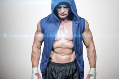 Composite image of athlete in hood looking down Stock Photography