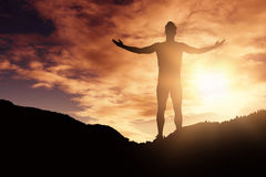 Composite image of athlete man standing with arms outstretched Stock Photography