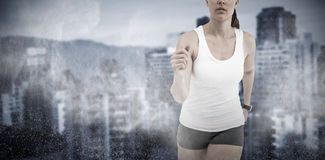 Composite image of athlete woman running on white background stock images