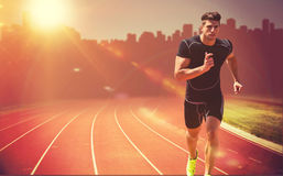 Composite image of athletic man jogging against white background. Athletic man jogging against white background against composite image of race track stock images