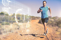 Composite image of athletic man jogging on country trail Stock Photo