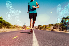 Composite image of athletic man jogging on open road. Athletic man jogging on open road against fitness interface royalty free stock photo
