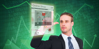 Composite image of attentively businessman in suit pointing up. Attentively businessman in suit pointing up against stocks and shares Stock Images