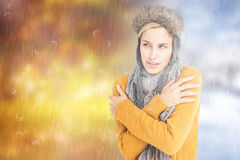 Composite image of attractive blonde wearing a warm hat Stock Photos