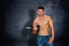 Composite image of attractive bodybuilder Royalty Free Stock Image