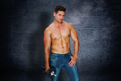Composite image of attractive bodybuilder Royalty Free Stock Images
