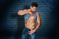 Composite image of attractive bodybuilder Stock Photo